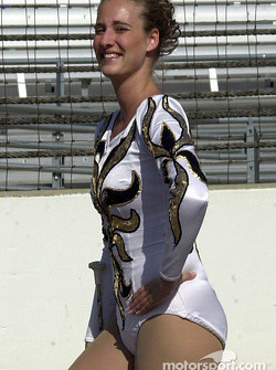 A cute majorette give the photographer a wink