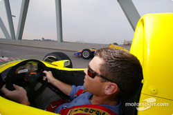 Scott Sharp and Robbie Buhl drive their cars on the streets of Kentucky during the Newport Festival