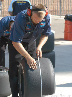 Crew member checks tire wear