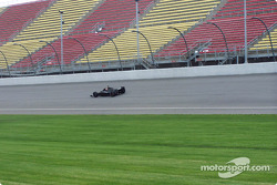 Robby Gordon speeds by the frontstretch while shaking down his Indianapolis 500 car