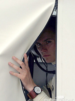 Dan Wheldon peeks out to see if it is still raining