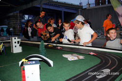 Young fans play slot car racing
