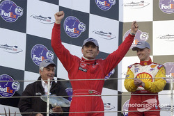 The podium: race winner Gil de Ferran, with Roger Penske and Kenny Brack