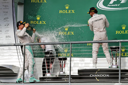 The podium (L to R): Nico Rosberg, Mercedes AMG F1 celebrates with Victoria Vowles, Mercedes AMG F1 Partner Services Director and race winner Lewis Hamilton, Mercedes AMG F1