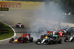 Max Verstappen, Red Bull Racing RB12 and Nico Rosberg, Mercedes AMG F1 W07 Hybrid at the start of the race