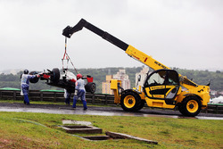 The Haas VF-16 of Romain Grosjean, Haas F1 Team is removed from the circuit after he crashed heading to the grid