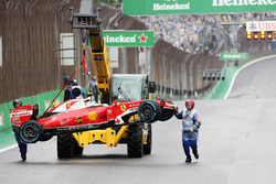 The Ferrari SF16-H of Kimi Raikkonen, Ferrari is removed from the circuit after he crashed out of the race