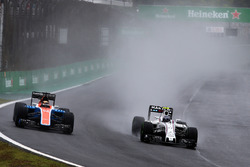 (L to R): Pascal Wehrlein, Manor Racing MRT05 and Valtteri Bottas, Williams FW38 battle for position