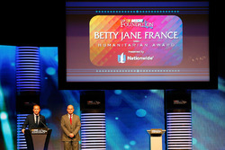 Brad Barnett, Associate Vice President, National Media and Sports Marketing for Nationwide, Andy Hoffman before getting the Betty Jane France Humanitarian Award Presented by Nationwide during the NASCAR NMPA Myers Brothers Awards Luncheon