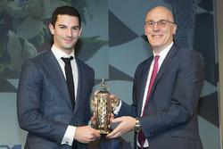 2016 Indy 500 winner Alexander Rossi is presented with the baby Borg-Warner Trophy by James Verrier of BorgWarner