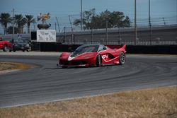 Chris Harris driving a Ferrari FXX K on a track