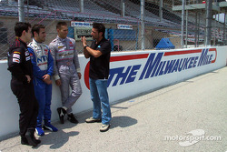 Alex Tagliani giving an on- track orientation at the Milwaukee Mile to Canadian drivers Stephan C. R