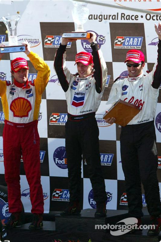 The podium: race winner and 2002 CART Champion Cristiano da Matta with Christian Fittipaldi and Jimmy Vasser