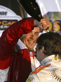 The podium: champagne shower for race winner Michel Jourdain Jr. and Oriol Servia