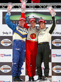 The podium: race winner Sébastien Bourdais with Paul Tracy and Bruno Junqueira