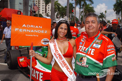 Arturo Romero with a grid girl