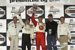 Paul Newman, Carl Haas, Bruce Willis, Sebastien and Bruno pose on the victory podium