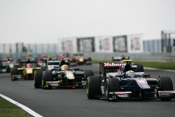 Marcus Ericsson leads the field on the opening lap of the race