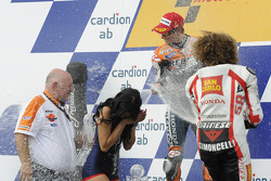 Podium: race winner Casey Stoner, Repsol Honda Team, third place Marco Simoncelli, San Carlo Honda Gresini