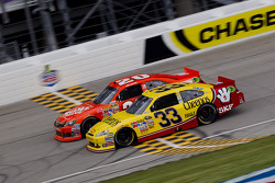 Clint Bowyer, Richard Childress Racing Chevrolet and Joey Logano, Joe Gibbs Racing Toyota