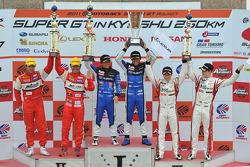 GT300 class podium: race winners Tetsuya Yamano, Kota Sasaki, second place Ryo Orime, Tsubasa Abe third place Tetsuya Tanaka, Katsuyuki Hiranaka