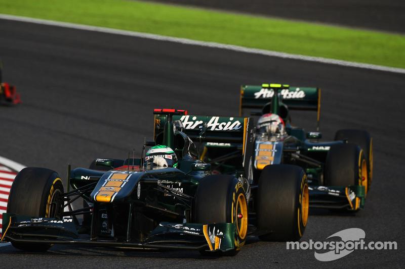 Heikki Kovalainen, Team Lotus leads Jarno Trulli, Team Lotus