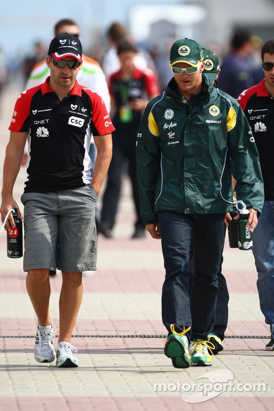 Timo Glock, Marussia Virgin Racing and Heikki Kovalainen, Team Lotus