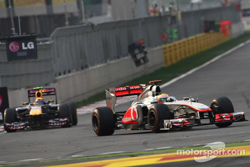 Lewis Hamilton, McLaren Mercedes leads Mark Webber, Red Bull Racing