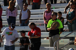 Fans watch as drivers complete a five lap tribute to Dan Wheldon