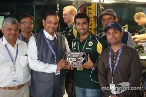 Karun shows Manoj Gaur, Executive Chairman, Jaypee Group, and family around the Team Lotus pits