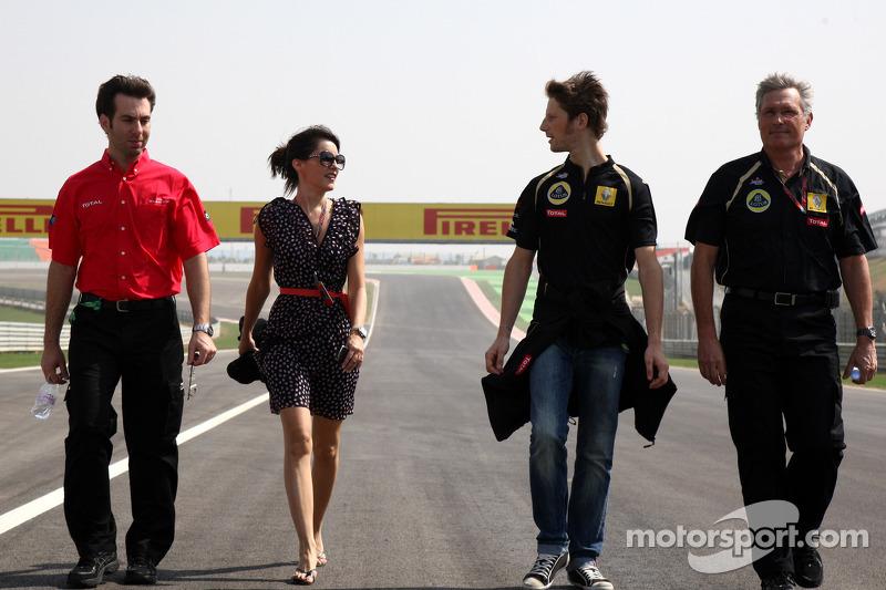 Romain Grosjean, , Lotus Renault GP and his girlfriend Marion Joles, walks the track