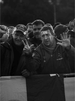 A fan celebrates Loeb's 8 WRC championships