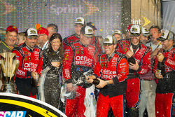 Victory lane: Stewart-Haas Racing team members celebrate with champagne