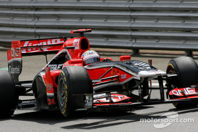 Timo Glock, Virgin Racing loses a wheel exit of the pitlane