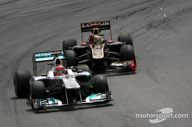 Michael Schumacher, Mercedes GP and Bruno Senna, Renault F1 Team