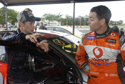 Casey Stoner tests a V8 Supercar with Craig Lowndes