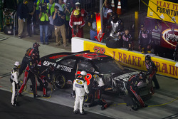 Regan Smith, Furniture Row Racing Chevrolet in the pits with damage