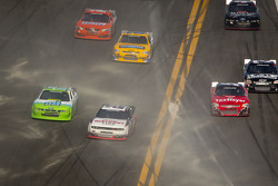 Brad Keselowski, Penske Racing Dodge leads a group of cars under caution