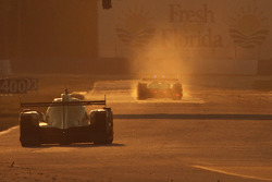Track action at sunset