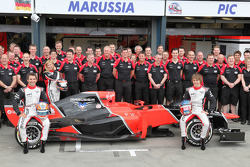 Marussia team photo with Timo Glock, Marussia F1 Team and Charles Pic, Marussia F1 Team