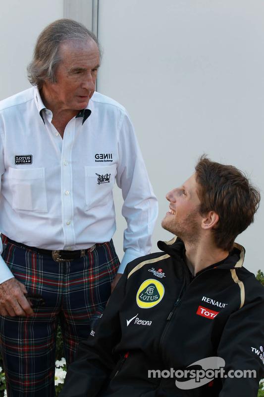 Sir Jackie Stewart with Romain Grosjean, Lotus Renault F1 Team