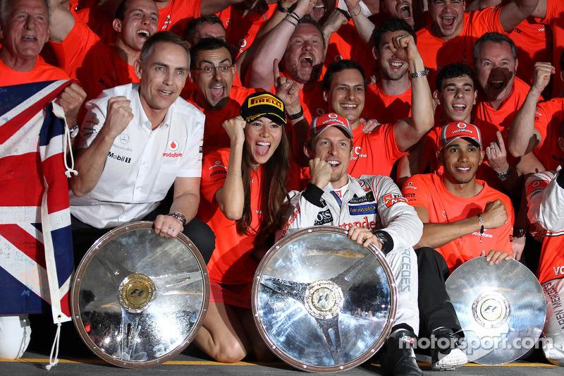 The McLaren team celebrate Jenson Button, McLaren Mercedes win with John Button, Martin Whitmarsh, McLaren, Chief Executive Officer, Jessica Michibata, McLaren Mercedes