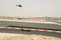 Lewis Hamilton, McLaren Mercedes tracked by a helicopter