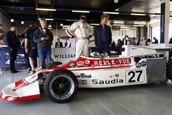 Nico Rosberg, stands next to a 1977 March 761, raced in period by Patrick Neve