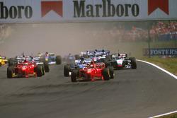 Михаэль Шумахер, Ferrari F310B, Деймон Хилл, Arrows A18 Yamaha и Эдди Ирвайн, Ferrari F310B