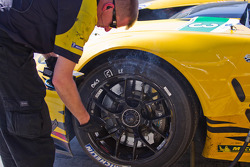 Corvette Pit Crew checking out the brakes after practice