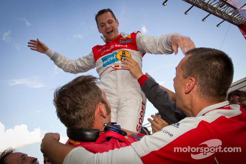Race winner Marc Basseng celebrates with Audi Sport Team Phoenix team members