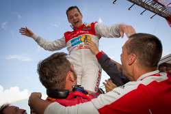 Race winner Marc Basseng celebrates with Audi Sport Team Phoenix team members