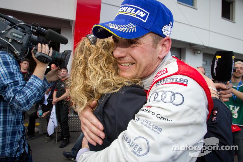 Race winner Marc Basseng celebrates with Christina Surer