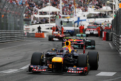 Race winner Mark Webber, Red Bull Racing leads second placed Nico Rosberg, Mercedes AMG F1 and third placed Fernando Alonso, Ferrari